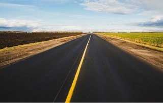 a long time coming, deserted road to horizon