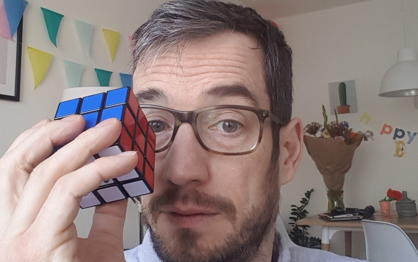 ryan millar face with rubik's cube