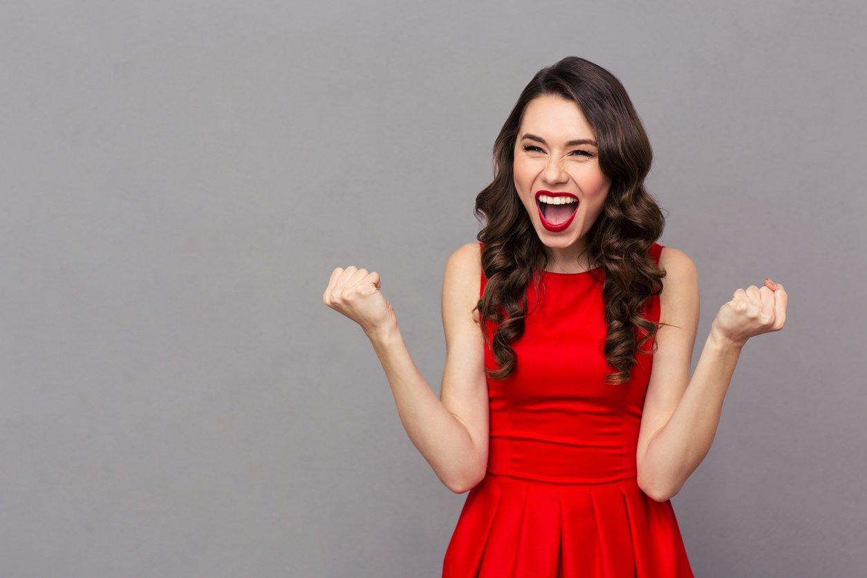 women in red dress, triumphant
